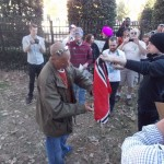 Counter-protesters attempt to burn a Nazi flag.