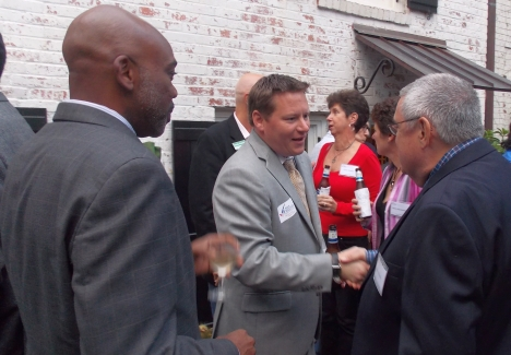 Democrat Al Austin, left, with Republican Mark Frietch, center, chat with MeckPAC supporter Barry Brodsky.