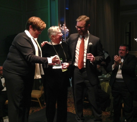 Janet Joyner, center, of Winston-Salem, accepts an award from former Equality NC Foundation chair Addison Ore and former Equality NC executive director Ian Palmquist.