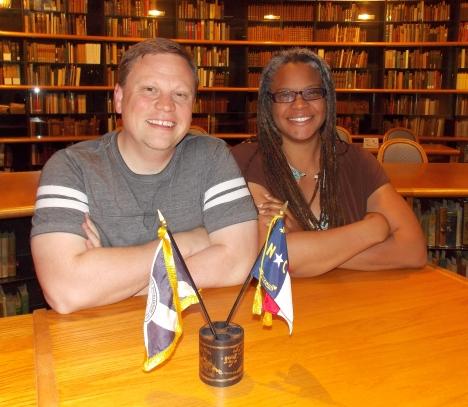 UNCC Multicultural Resource Center staffer Joshua Burford, left, with UNCC archivist Meredith Evans.
