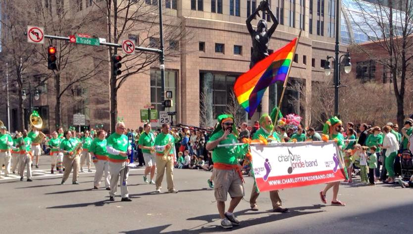The Charlotte Pride Band marches in the 2014 Charlotte St. Patrick's Day Parade, making history as the first LGBT group to march openly with a rainbow flag and being publicly identified as an LGBT organization.