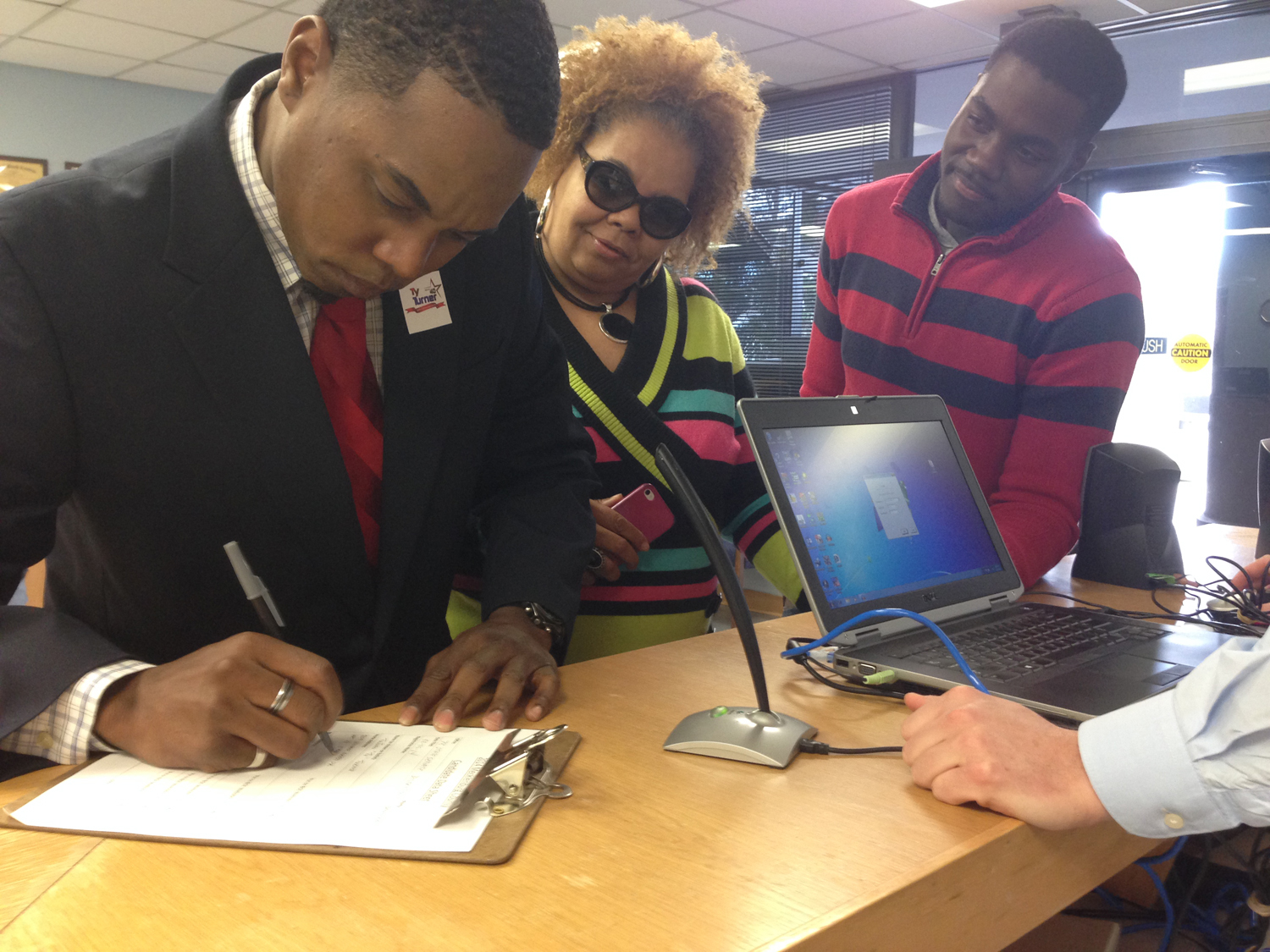 Ty Turner, left, files to run for office on Feb. 25 at the Mecklenburg County Board of Elections with his mother, Sonia Graddick, and brother, Stephen Graddick.