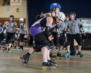 The Charlotte Roller Girls jammed their way through the Brandywine Roller Girls defense. Photo Credit: Andrew Keyes