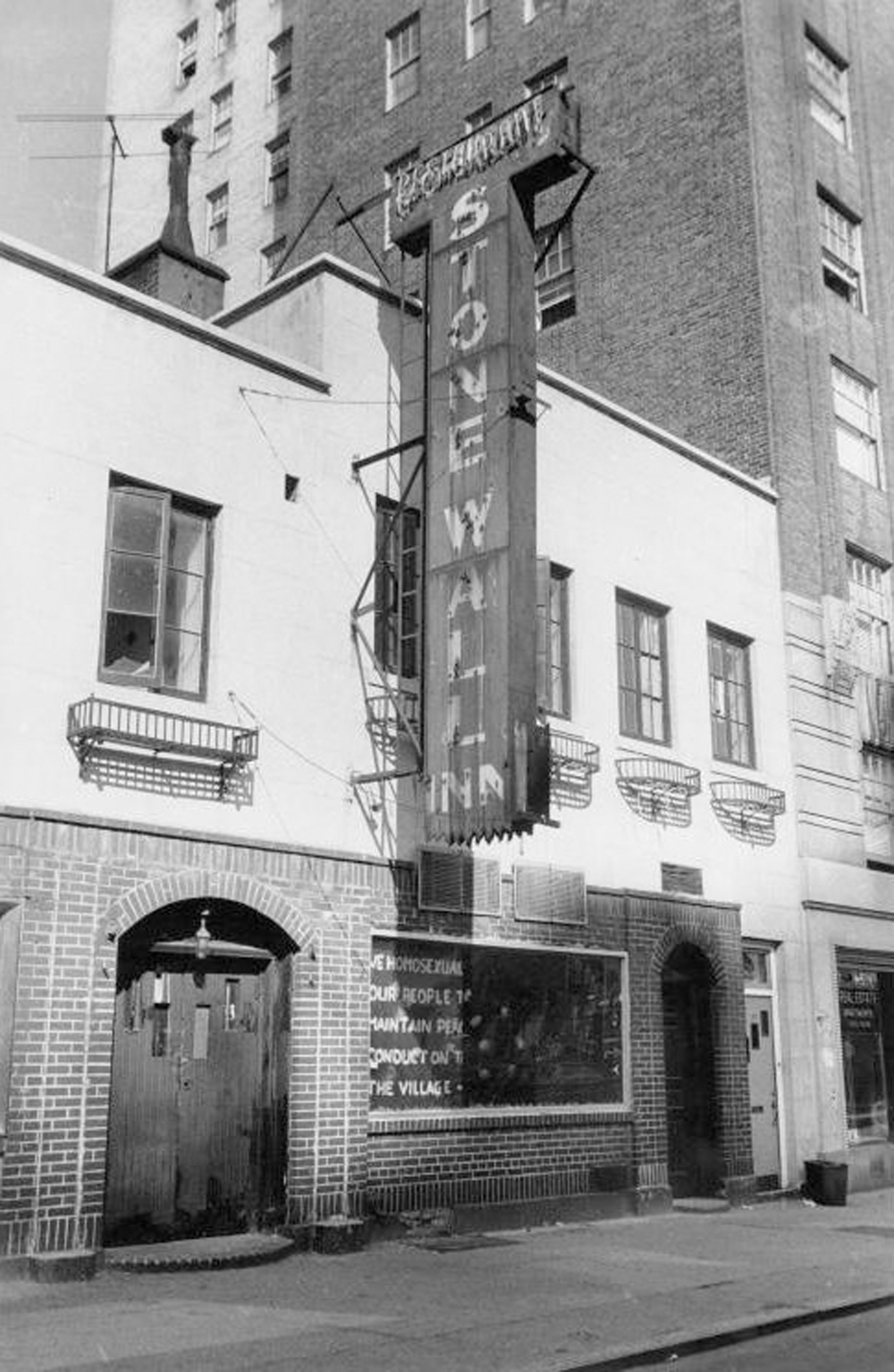"The Stonewall Inn, following the riots on June 28, 1969. The sign on the window reads, ""We homosexuals plead with our people to please help maintain peaceful and quiet conduct on the streets of the Village—Mattachine."" Photo Credit: Diana Davies/New York Public Library"