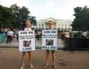 Andrew Nasonov, right, stands with Artem Gorbunov, left, at their protest and awareness action in front of the White House.
