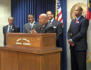 Pastor Johnny Hunter standing at the General Assembly press conference podium during a media event in 2011.