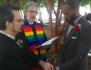 LeMond Hart, right, and partner Jerry Crayton, left, are married outside the Mecklenburg County Register of Deeds office on Monday, Oct. 13, by Concord's Trinity United Church of Christ Pastor Nathan King.