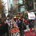 featured image Protesters shut down Uptown square, march down Tryon St.