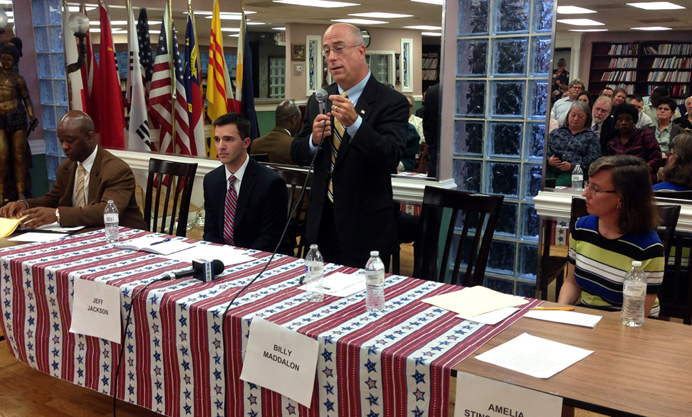 Billy Maddalon speaks at a candidates' forum in the days before Mecklenburg County Democrats appointed Jeff Jackson, seated at Maddalon's right, to a vacant state Senate seat.