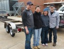 One World Dragon Boat recently picked up their trailer from Central Piedmont Community College's welding class. Pictured are student Brian Durrette, One World founder Denise Bauer, paddler Jennifer Stockwell and student Jonathan Skaggs.