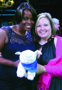 """Gwen Pearson and Barbara Green with """"Wilbur,"""" the new mascot of Pearson's relaunched VisitGayCharlotte.com, at the recent Charlotte Business Guild Giving Gala in March. Photo Credit: Gwen Pearson/Facebook."""