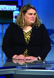 """Paige Dula on the set of NBC Charlotte's """"Flash Point,"""" during the lead up to Charlotte's vote on LGBT-inclusive non-discrimination ordinances. Photo Credit: WCNC/TV still"""