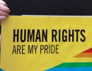"A Pride participant holds a sign saying ""Human Rights Are My Pride"" at the 2010 Dublin Pride celebration. Photo Credit: William Murphy, via Flickr. Licensed CC."