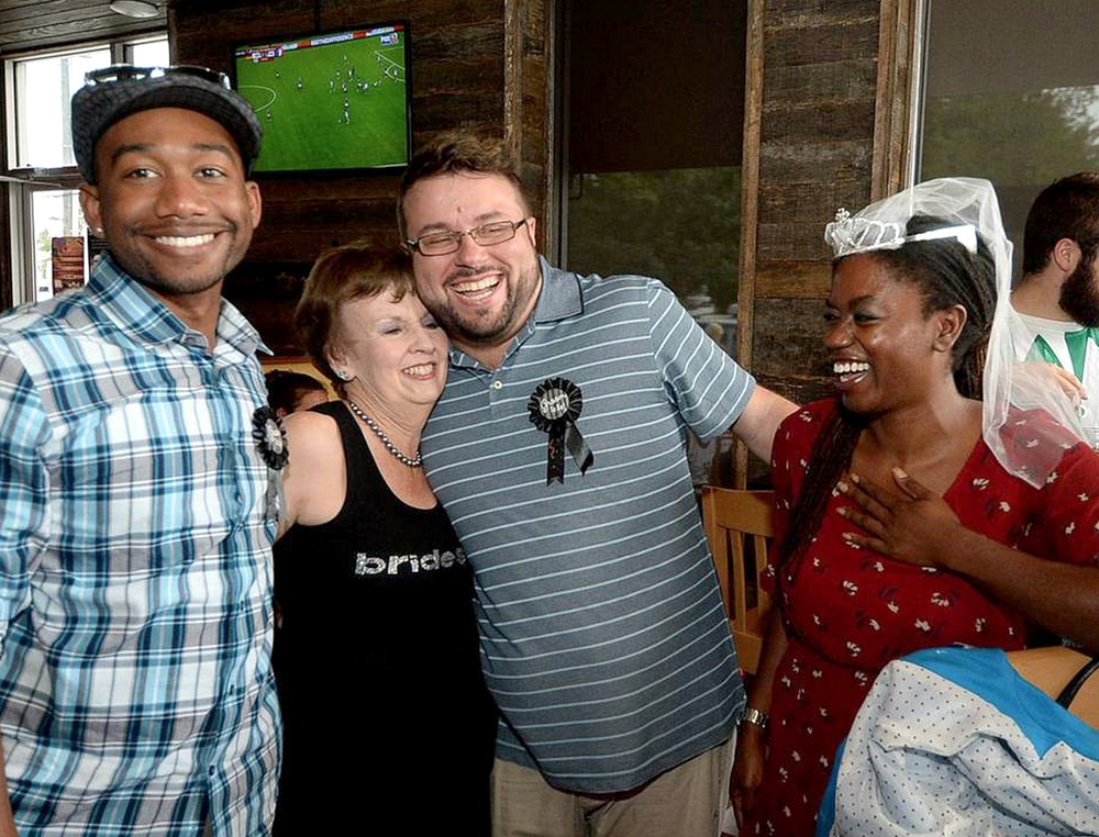 Nate Turner, left, County Commissioner at Large Pat Cotham, 2nd from left, Chad Sevearance, 3rd from left, President of the Charlotte Business Guild, and Crystal Richardson of Equality NC, right, celebrate at the June 26 event. Photo Credit: Diedra Laird, Charlotte Observer