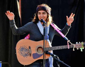 "Lara Americo performs at a post-election ""Love Wins"" rally. Photo Credit: The Charlotte Observer, Diedra Laird"